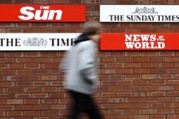 News International, a subsidiary of Rupert Murdoch's News Corporation, owns The Sunday Times, The Sun, and News of the World.