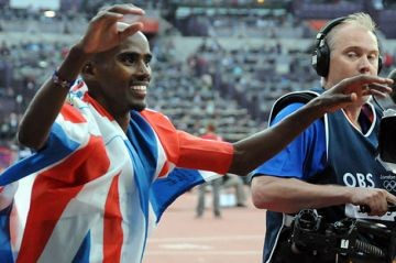 Mo Farah celebrates his victory in the Men's 5000 metres at the London 2012 Olympics.
