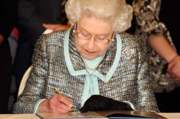 The Queen signs the Commonwealth Charter at Marlborough House in London, 11 March 2013. The Charter is an historic document which brings together, for the first time in the association's 64-year history, key declarations on Commonwealth principles.