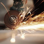 Factory machinery with sparks flying