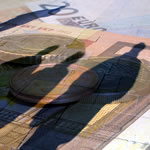Human shadows being cast on euro notes