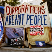 protest sign saying 'corporations are not people'