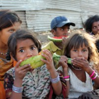 children eating watermelons