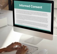 person reviewing consent form on computer