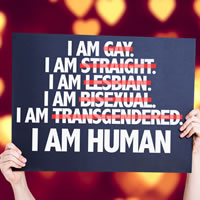 Sign being held up saying I Am Human